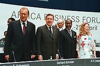 27 APR 2000, BERLIN/GERMANY:<br /> Jürgen E. Schrempp, Vorstandsvorsitzender DaimlerChrysler AG und Vorsitzender SAFRI, Gerhard Schröder, SPD, Bundeskanzler, Joaquim Alberto Chissano, President Rep. Mosambik, Bianca Buchmann, Afrika-Verein, auf dem Podium des Africa-Business Forum 2000 von Afrika-Verein und SAFRI - Southern Africa Initiative of German Business, debis Haus, Potsdamer Platz<br /> Juergen E. Schrempp, CEO of DaimlerChrysler and Chairman of SAFRI, Gerhard Schroeder, Federal Chancellor Germany, Joaquim Alberto Chissano, President Rep. Mozambique, and Bianca Buchmann, Afrika-Verein, Africa-Business Forum 2000<br /> IMAGE: 20000427-01/01-12