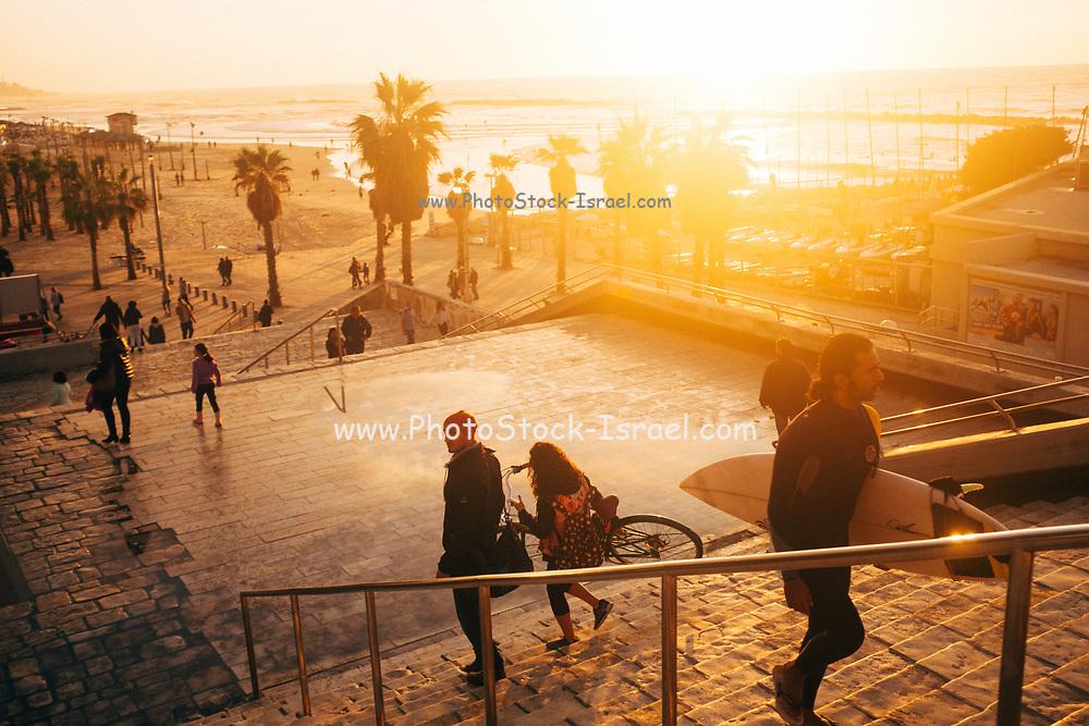 People descending to Gordon Beach, Tel Aviv at sunset