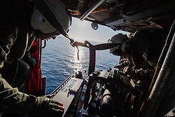 PACIFIC OCEAN (Aug. 12, 2018) Naval Air Crewman (Helicopter) 1st Class Stuart Holloway, left and Naval Air Crewman (Helicopter) 2nd Class Adriana Ramirez, mount a .50-caliber machine gun on an MH-60S Sea Hawk helicopter assigned to Helicopter Sea Combat Squadron (HSC) 14. John C. Stennis is underway conducting routine operations in the U.S. 3rd Fleet area of operations. (U.S. Navy photo by Mass Communication Specialist Seaman Apprentice Joshua Leonard/Released)180812-N-IL409-0046