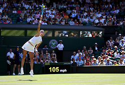 Garbine Muguruza serves on day two of the Wimbledon Championships at the All England Lawn Tennis and Croquet Club, Wimbledon.