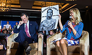 Republican presidential candidate Sen. Ted Cruz, R-Texas, reacts to a poster displayed by moderator Rebecca Hagelin at a campaign stop Wednesday, March 30, 2016, in Madison, Wis. (AP Photo/Andy Manis)