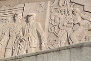Bas relief with the likenesses of men on the base of Monument to the Peoples Heroes, the Bund, Shanghai, China