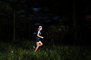 Greenville, New York - A runner enters Huckleberry Ridge State Forest during the  Shawangunk Ridge Trail Run/Hike 70-mile race  on Sept. 15, 2017.
