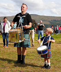 .An impromptu parade down Inveraray Main Street by some of the members of the newly crowned World Champions, Inveraray and District Pipe Band.Pipe Major Stuart Liddell and his son Alexander celebrate the victory.... (c) Stephen Lawson | Edinburgh Elite media