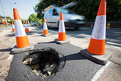 © Licensed to London News Pictures. 06/06/2016. Keighley UK. Picture shows a sinkhole that has opened up on Oakworth Road in Keighley, Yorkshire. Photo credit: Andrew McCaren/LNP