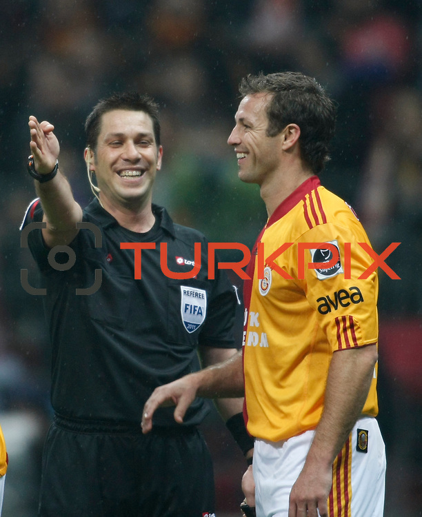 Referee's Firat AYDINUS (L) and Galatasaray's Lucas NEILL (R) during their Turkish superleague soccer derby match Galatasaray between Fenerbahce at the Turk Telekom Arena in Istanbul Turkey on Friday, 18 March 2011. Photo by TURKPIX