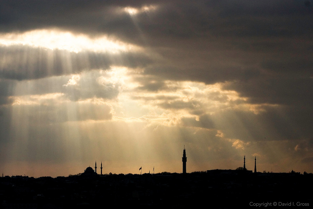 Sun streams through the clouds over the Golden Horn in Istanbul, Turkey, backlighting the St. Sofia and Topkapi palace.