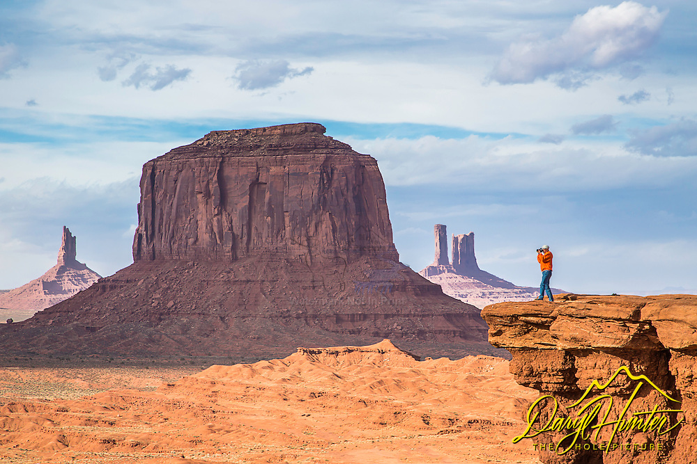 Photographer Jim Osterhout shooting it out at John Ford Point in Monument Valley Arizona.