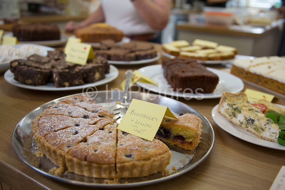 Local community Sunday market in the village of Husthwaite, North Yorkshire, England, UK. Over 20 stalls with a mixture of old favourites and new stalls lelling locally made products. The Apple Tree Cafe which serving tea, coffe, and home-made cakes.