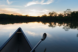 Canoe and sunset on water near Big Big Springpring after Trinity River flood, Great Trinity Forest, Dallas, Texas, UBig SpringA