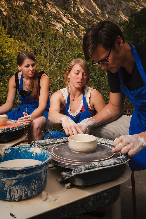 Kim Hall instructs a pottery throwing class.