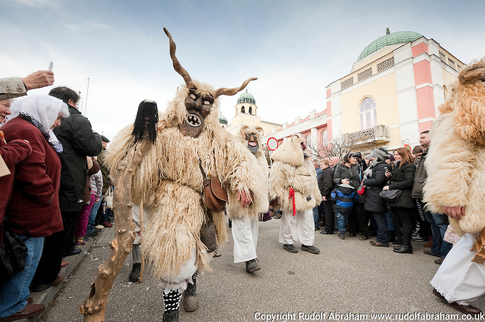 Busó carnival, Mohács, Hungary. The busós arriving on the town's main square at the end of the procession, passing in front of the Town Hall. The Busó carnival or Busójárás is inscribed on the UNESCO list of Intangible Cultural Heritage. © Rudolf Abraham