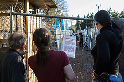London, UK. 26th February, 2019. Residents of Grow Heathrow communicate with bailiffs from the National Eviction Team. The squatted eco-community garden was founded in 2010 on a previously derelict site close to Heathrow airport in protest against government plans for a third runway and is since acknowledged to have made a significant educational and spiritual contribution to life in the Heathrow villages which are threatened by airport expansion. Bailiffs have evicted the protesters from the front section of the site, owned by Imran Malik, removing several protesters locked on in towers above the camp, but four protesters are believed to remain in a tunnel beneath that area. Many more protesters remain on the rear portion of the site. Five legal challenges to the government's approval of a 3rd runway at Heathrow will proceed to judicial review at the Royal Courts of Justice on 10th March.