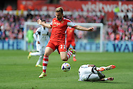 Southampton's  Luke Shaw in action.Barclays Premier league match, Swansea city v Southampton at the Liberty stadium in Swansea, South Wales on Saturday 3rd May 2014.<br /> pic by Andrew Orchard, Andrew Orchard sports photography.