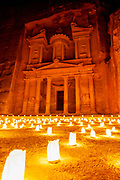 "One of the ""Seven Wonders of the World"" Al-Khazneh or The Treasury at night with luminaries, Petra, Jordan"