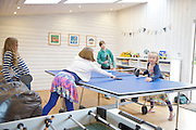 The games room at Pickwell Manor, Georgeham, North Devon, UK. From left to right: Molly Elliott (10), Liza Baker (9), Zac Baker (11), <br /> Milly-grace Elliott (8).<br /> CREDIT: Vanessa Berberian for The Wall Street Journal<br /> HOUSESHARE