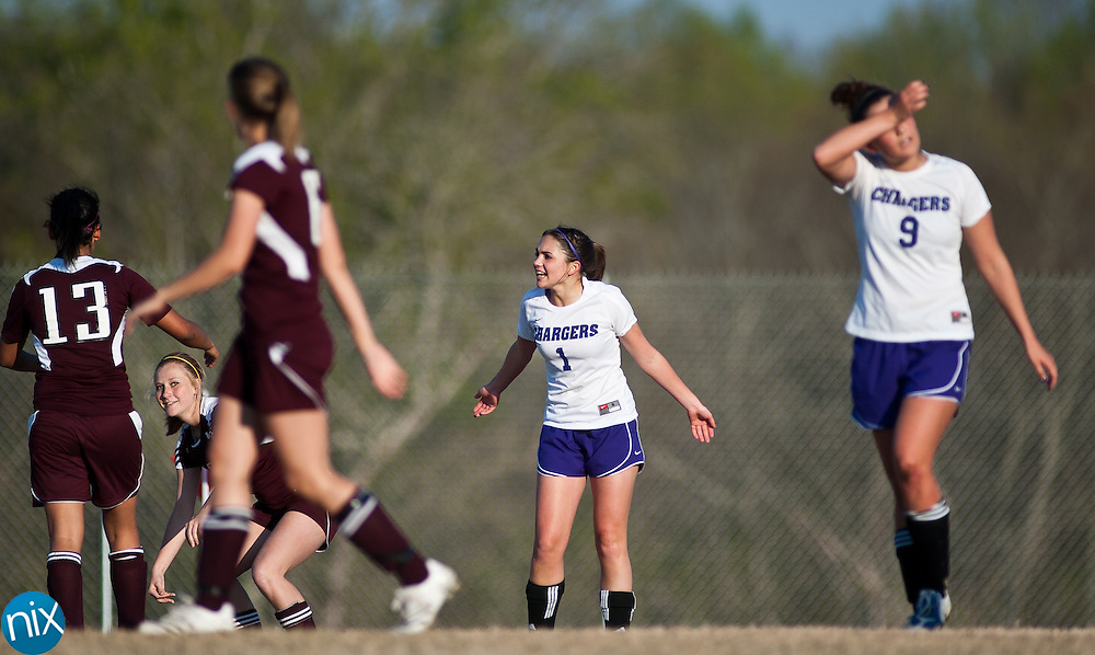 Cox Mill's Jenna Siffringer (1) reacts after being called for a foul against Jay M. Robinson Tuesday afternoon at Cox Mill High School in Concord. Robinson held off the Chargers 2-1.  (Photo by James Nix)