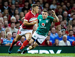 Jarrod Evans of Wales under pressure from Andrew Conway of Ireland<br /> <br /> Photographer Simon King/Replay Images<br /> <br /> Friendly - Wales v Ireland - Saturday 31st August 2019 - Principality Stadium - Cardiff<br /> <br /> World Copyright © Replay Images . All rights reserved. info@replayimages.co.uk - http://replayimages.co.uk