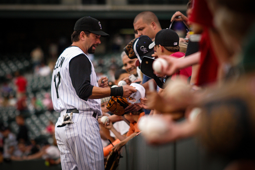 Always a fan favorite, Colorado Rockies first baseman TODD HELTON #17 signs autographs before defeating the San Francisco Giants 4-3 in MLB action.