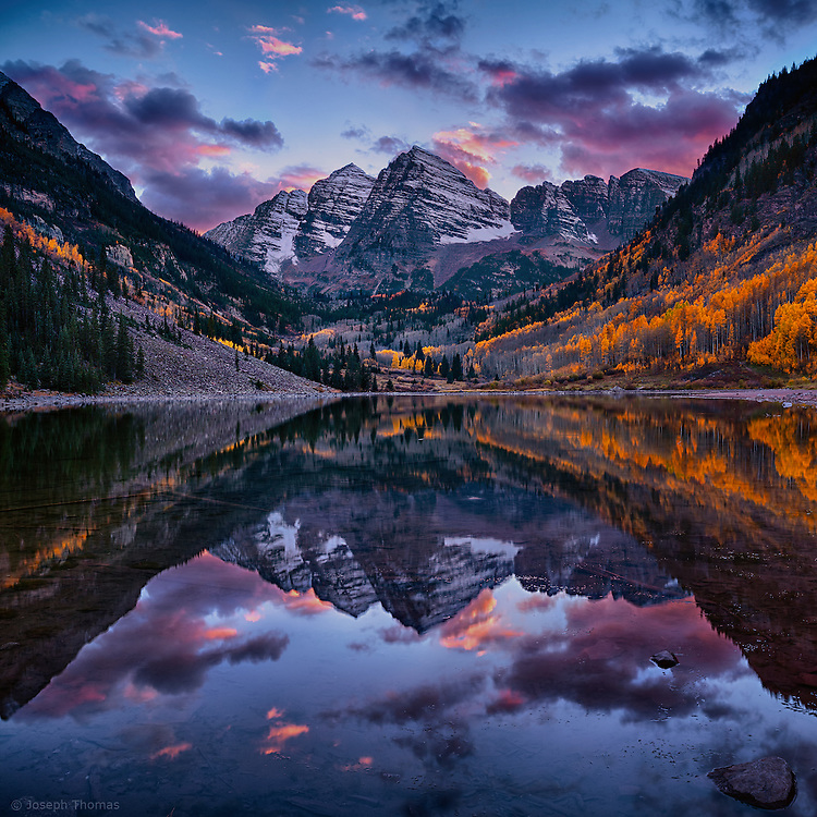 The striking symmetry of Maroon Bells is reflected in Maroon Lake on this perfect autumn day.<br /> <br /> Melodic inversion is a compositional technique where the composer takes the original melody and turns it upside down. Here the composer is nature and the melody played by the Bells is among the most beautiful in the world.