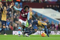 Carlos Sanchez of Aston Villa fouls Joel Campbell of Arsenal - Mandatory byline: Dougie Allward/JMP - 13/12/2015 - Football - Villa Park - Birmingham, England - Aston Villa v Arsenal - Barclays Premier League