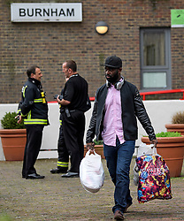 © Licensed to London News Pictures. 24/06/2017. London, UK. Residents are evacuated from the Burnham block on the Chalcots Estate in Camden after it failed a fire inspection because of combustable cladding. More than 700 flats in tower blocks on an estate in the Swiss Cottage area of north-west London are being evacuated because of fire safety concerns. Photo credit: Ben Cawthra/LNP