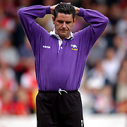 The pressure begins to tell on Derby County's manager John Gregory during the first half