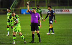 Referee Brett Huxtable shows a a yellow card to Carl Winchester of Forest Green Rovers- Mandatory by-line: Nizaam Jones/JMP - 14/11/2020 - FOOTBALL - innocent New Lawn Stadium - Nailsworth, England - Forest Green Rovers v Mansfield Town - Sky Bet League Two