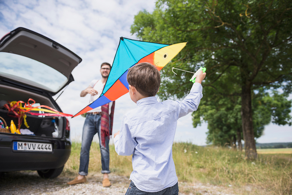 Man and his son with kite in the countryside, Bavaria, Germany
