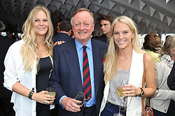 Left to right, LADY PHILLIPA HOWARD daughter of the Earl of Suffolk & Berkshire, ANDREW PARKER BOWLES and LADY NATASHA HOWARD daughter of Earl of Suffolk & Berkshire at a party to celebrate the publication on 'Let's Eat: Recipes From My Kitchen Notebook' by Tom Parker Bowles held at Selfridge's Rooftop. Selfridge's, Oxford Street, London on 27th June 2012.