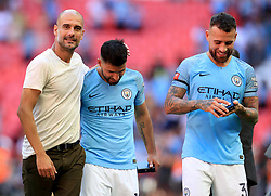 Manchester City manager Josep Guardiola with Sergio Aguero after the Community Shield match at Wembley Stadium, London.