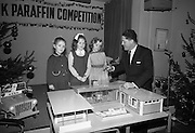"Presentations at Shell and BP, Fleet Street..1964..18.12.1964..12.18.1964..18th December 1964..At Shell & BP house in Fleet Street, Dublin, the Minister for Justice, Mr Brian Lenihan TD was on hand to present prizes to young winners in ""The Pink Paraffin""competition...Image shows The Minister for Justice, Mr Brian Lenihan TD,showing a dolls house to three young girls at the prizegiving ceremony in Dublin."