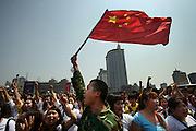 A Chinese mourner waves a flag as a crowd shouts nationalist slogans after a three minute silence to grieve Sichuan's earthquake victims in Chengdu's central square.