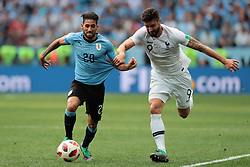 July 6, 2018 - Nizhny Novgorod, U.S. - NIZHNY NOVGOROD, RUSSIA - JULY 06: forward Jonathan Urretaviscaya of Uruguay in action with forward Olivier Giroud of France during the Quarter-Final match between Uruguay and France in the 2018 FIFA World Cup on July 6, 2018, at Nizhny Novgorod Stadium in Nizhny Novgorod, Russia. (Photo by Anatoliy Medved/Icon Sportswire) (Credit Image: © Anatoliy Medved/Icon SMI via ZUMA Press)