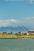 View of Torcello Island from Burano island with the Dolomite Mountain ranges in the background.Venice, Italy, Europe