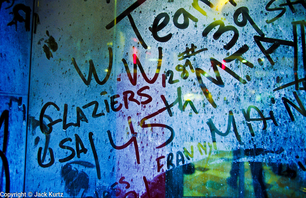 """22 SEPTEMBER 2011 - NEW YORK, NY: People have written in the dust encrusted windows of a closed deli on Liberty Street in lower Manhattan near """"Ground Zero"""" at the World Trade Center complex after the WTC terrorist attack, Sept. 22, 2001. More than 2,900 people were killed when terrorists crashed two airliners into the towers on Sept. 11, 2001. Everything for miles around the WTC was covered in dust and ash when the 110 story tall towers collapsed.  PHOTO BY JACK KURTZ"""
