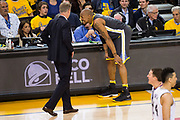 Golden State Warriors forward David West (3) reacts to injuring his ankle during Game 2 of the Western Conference Quarterfinals against the San Antonio Spurs at Oracle Arena in Oakland, Calif., on April 16, 2018. (Stan Olszewski/Special to S.F. Examiner)