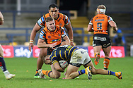 Junior Moors and Jake TRueman tackle a Leeds player  during the Betfred Super League match between Leeds Rhinos and Castleford Tigers at Emerald Headingley Stadium, Leeds, United Kingdom on 26 October 2020.