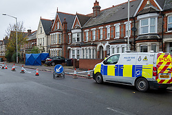 © Licensed to London News Pictures. 12/11/2020. Reading, UK. A police dog unit van parked next to a section of Oxford Road cordoned off as a forensic tent sits inside a property. Thames Valley Police is investigating the unexplained  death of a man in Reading. At approximately 04:55GMT South Central Ambulance Service called police officers to a house on Oxford Road, Reading. On attendance they found that a man in his fifties had died. A 44-year-old man, a 38-year-old man and a 43-year-old man all from Reading have been arrested on suspicion of murder. Photo credit: Peter Manning/LNP
