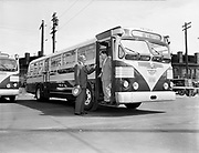 Y-480815D-03.  New twin coach bus at Center St. Steel & Richardson. August 15, 1948.