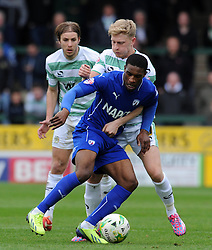 Chesterfield's Tendayi Darikwa is tackled by Yeovil Town's Ajay Leitch-Smith - Photo mandatory by-line: Harry Trump/JMP - Mobile: 07966 386802 - 03/04/15 - SPORT - FOOTBALL - Sky Bet League One - Yeovil Town v Chesterfield - Huish Park, Yeovil, England.
