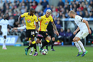 Odion Ighalo of Watford (24) attempts a back heel to Valon Behrami of Watford (c). Premier league match, Swansea city v Watford at the Liberty Stadium in Swansea, South Wales on Saturday 22nd October 2016.<br /> pic by  Andrew Orchard, Andrew Orchard sports photography.