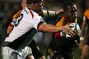 Sitiveni Sivivatu braking a tackle of Greg Somerville of the Chiefs 38-10 win,during the Investec Super 15 Rugby match, Chiefs v Rebels, at Waikato Stadium, Hamilton, New Zealand, Saturday 5 March 2011. Photo: Dion Mellow/photosport.co.nz