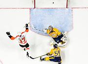 Philadelphia Flyers right wing Wayne Simmonds (17) celebrates his second goal scored against Nashville Predators goalie Pekka Rinne (35) during the third period of an NHL game on Thursday, Feb. 4, 2016, in Nashville, Tenn. NICK WAGNER / CAL SPORT MEDIA