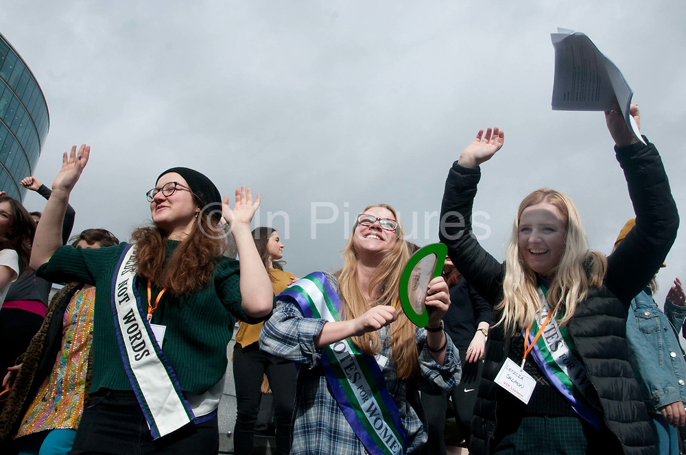 March 4th 2017. Thousands of people, mostly women and girls, marched across Tower Bridge in an event organised by Care International to mark International Womens Day March 8th and the need for gender equality. Young women celebrate including left Laura Pankhurst, great great-granddaughter of Emmeline Pankhurst and great granddaughter of Sylvia Pankhurst, leaders in the British suffragette movement.
