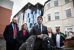 """© Licensed to London News Pictures. 16/11/2019. Bolton, UK. PAUL DENNETT of Greater Manchester's High Rise Taskforce , Deputy Mayor of Greater Manchester BEV HUGHES , Mayor of Manchester ANDY BURNHAM and SANDRA RUIZ and TIAGO ALVES of Grenfell United, both of whom are former Grenfell Tower residents , at a press conference at the site of the blaze . Firefighters work at the scene where a fire broke out overnight (15th/16th November 2019) at a block of flats known as """" The Cube """" , in Bolton Town Centre . At least two people are known to have been treated by paramedics at the scene of the six-story block , which is occupied by students of the University of Bolton . Photo credit: Joel Goodman/LNP"""