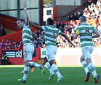 09/11/14 SCOTTISH PREMIERSHIP <br /> ABERDEEN v CELTIC <br /> PITTODRIE - ABERDEEN<br /> Celtic's Stefan Johansen (left) celebrates with his team-mates Emilio Izaguirre and Scott Brown having scored the equaliser
