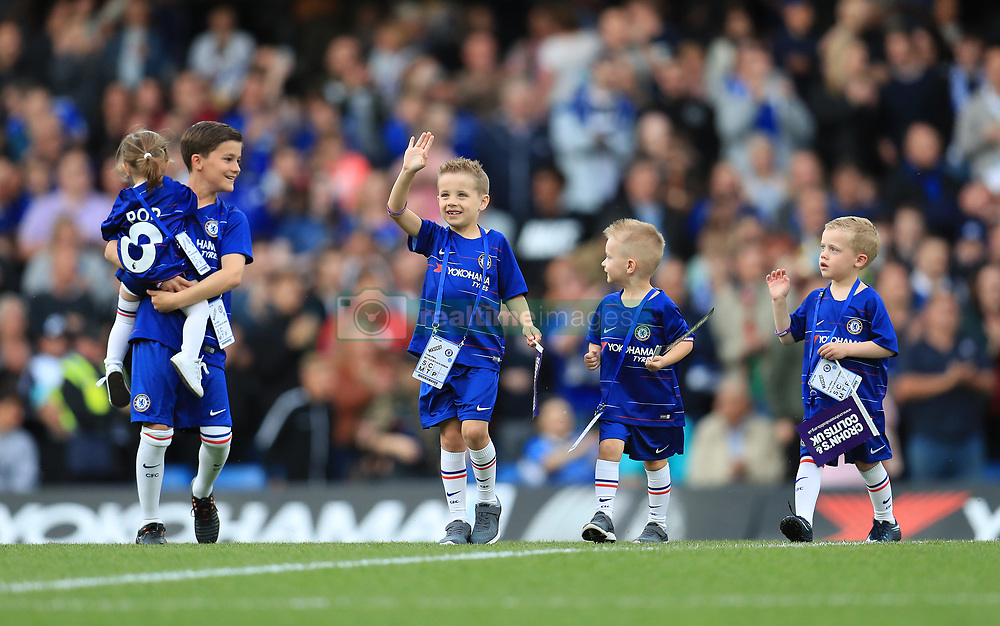 Ray Wilkins' grandchildren lead the teams out before the legends match at Stamford Bridge, London.