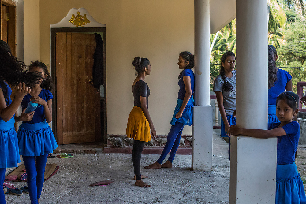 Ruth, center, and her friends taking a break from learning traditional Kandyan dance at the Amunugama Dancing School, the first dancing school in Sri Lanka that opened in 1943 under British rule. Kandy, Sri Lanka