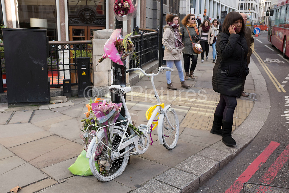 Ghost bike in central London. A ghost bike or ghostcycle is a bicycle set up as a roadside memorial in a place where a cyclist has been killed or severely injured (usually by a motor vehicle). Apart from being a memorial, it is usually intended as a reminder to passing motorists to share the road. Ghost bikes are usually junk bicycles painted white, sometimes with a placard attached, and locked to a suitable object close to the scene of the accident. Many of these memorials are political statements erected by individuals who aim to make a wider point beyond personal loss regarding general road cyclist awareness.
